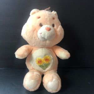 Vintage Kenner Care Bear Friend Bear flowers plush